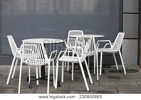 Restaurant Zone With White Plastic Chairs And White Tables In The Lobby Of The Mall. Beautiful Inter