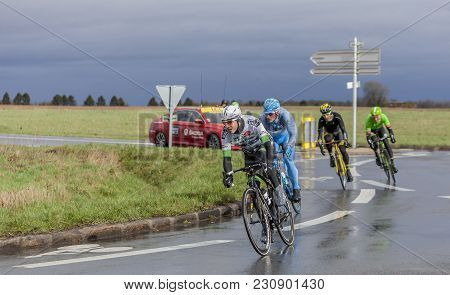 Cernay-la-ville, France - March 5, 2017: The Breakaway Taking A Curve On A Wet Road During The First