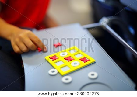 Tic Tac Toe Game. Leisure Activity For Kids And Adults. At Home, Traveling, On Plane. Closeup Of Han