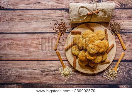 Freshly Baked Scones On A Wooden Plate With Cinnamon Sticks And Different  Spices On Wooden Spoons,