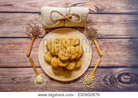 Freshly Baked Scones On A Wooden Plate With Different  Spices On Wooden Spoons, Top View