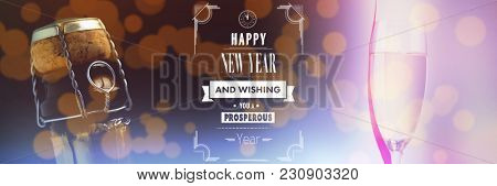 Happy New Year message against champagne flute with ribbon