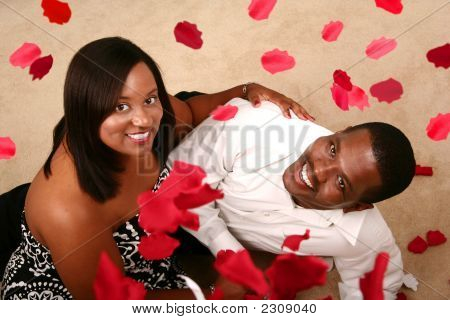 Romantic African American Couple Watching Falling Rose Petal