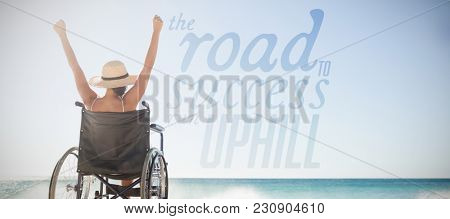 The road to success run uphill against wheelchair woman sitting with arms up