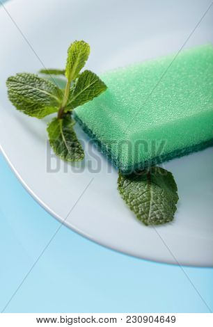 White Dish And Sponge For Dishes .