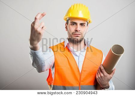 Portrait Of Young Architect Holding Fingers Crossed