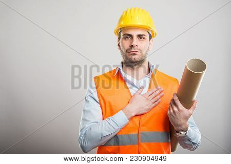 Portrait Of Young Architect Holding Blueprints Staking Oath