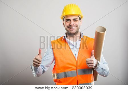 Portrait Of Young Architect Holding Blueprints Showing Double Like