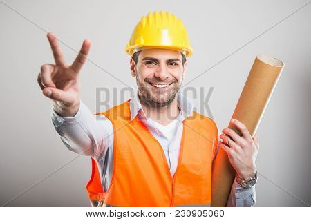 Portrait Of Young Architect Showing Peace Gesture