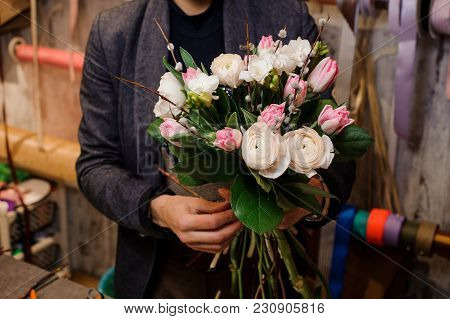 Man Holding A Beautiful Bouquet Of Tender Flowers Consisting Of Pink Tulips And White Ranunculus