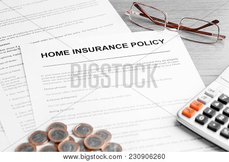 Home Insurance Policy. Calculator, Glasses, Documents And Euro Coins On Table. Business And Insuranc