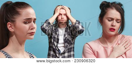 Husband, Wife, Mistress. Depressed People. Young Man And Women Standing Close To Each Other While Is