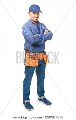 Plumber with tool belt on white background