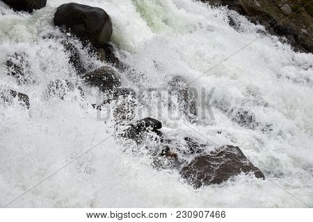 Rapid Course Of A Mountain River. Mountain River Is A River That Runs Usually In Mountains, In Narro