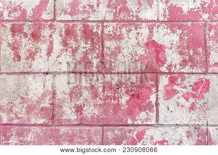 Old Shabby Concrete Wall Texture. Rectangular Blocks With Cracked Plaster And Peeling Magenta Paint
