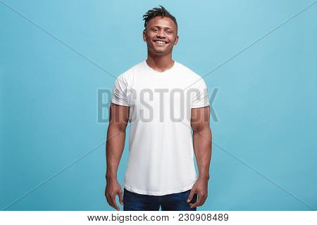 Happy Business Man Standing And Smiling Isolated On Blue Studio Background. African American Male Ha