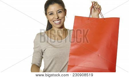 Young Attractive And Happy Latin Woman Holding Red Shopping Bag Smiling Cheerful And Positive Isolat