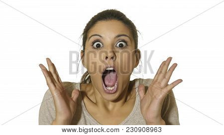 head portrait of young happy and excited hispanic woman 30s in surprise and astonished face expression eyes and mouth wide open isolated on white background in emotions concept poster
