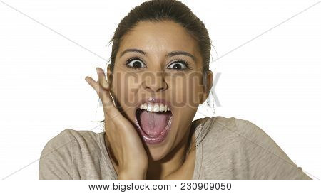 Head Portrait Of Young Happy And Excited Hispanic Woman 30s In Surprise And Astonished Face Expressi