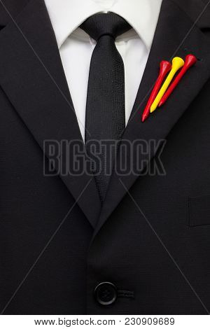 The Detail Of Wedding Suit With Golf Design.golf Tees In The Color Of Spanish Flag On The Flap Of Bl