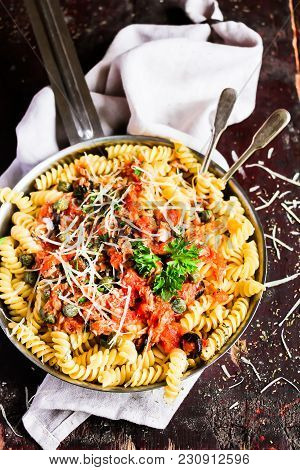Pasta Fusilli Meal With Canned Tuna Fish, Tomato Sauce, Black Olives, Grated Cheese And Parsley In A