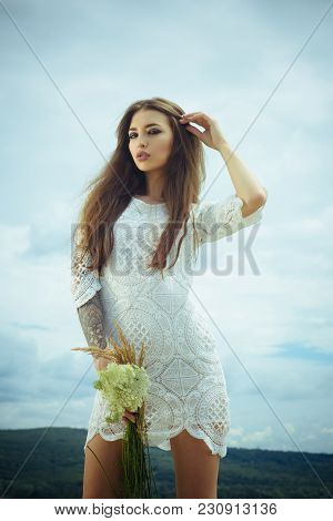 Sensual Woman With Flowers Cloudy Sky, Beauty. Woman With Floral Bouquet, Fashion. Skincare, Treatme