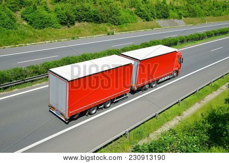 Truck on the highway. Cargo transportation concept.
