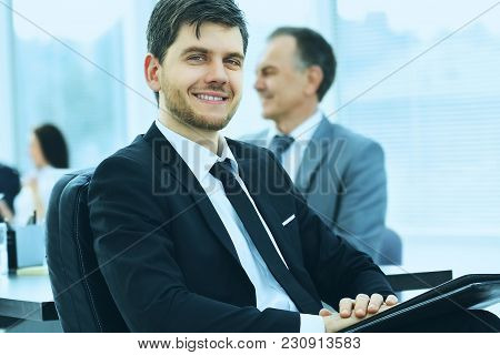 Portrait Of A Successful Businessman In The Office On The Background Of Their Team In The Office