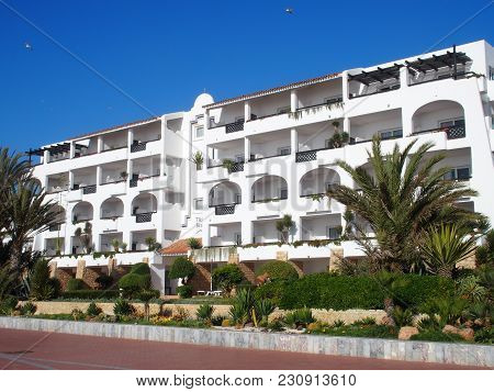 Agadir, Morocco On February 2017: White Modern Hotel Building And Palms In Beauty Outdoor Seating Pl