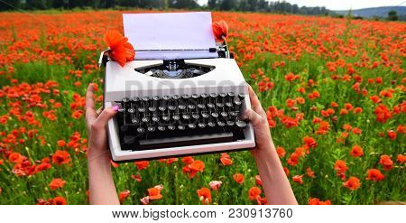 Vintage Typewriter In Hand, Education, Business, Grammar. Vintage Style Typewriter In Female Hand
