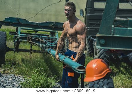 Sexy Worker Concept. Muscular Builder On Sunny Day. Sexy Man With Nude Torso Work With Construction