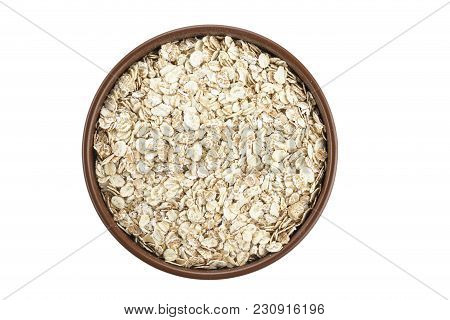 Raw Oatmeal In A Plate, Healthy English Breakfast, Isolated On A White Background