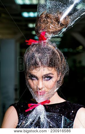 Woman Face Makeup Wrapped In Overwrap, Pack. Girl With Transparent Wrapper On Face, Present. Beauty,