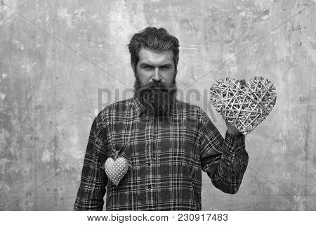 Bearded Serious Man With Two Hearts