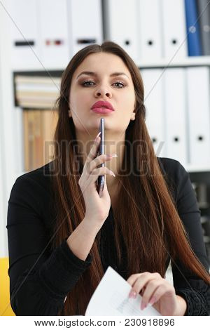 Beautiful Brunette Smiling Businesswoman Hold In Arm Cellphone In Office Workplace Portrait. Stay In