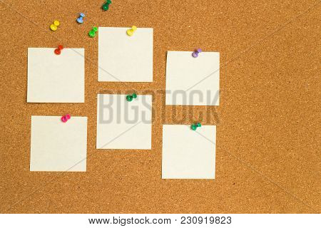 Empty Yellow Sticky Notes On Cork Board With Color Pins
