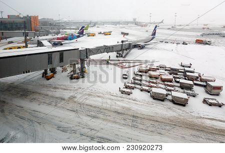 Moscow/ Russia - December 26, 2017. A Jetway Bridge In The Winter. International Sheremetyevo Airpor