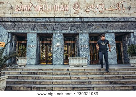 Tehran, Iran - October 15, 2016: Iranian Man On A Stairs In Front Of Iranian Melli Bank In Tehran