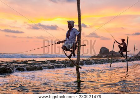 Koggala, Sri Lanka - March 22, 2016: Local Men Fishing In Traditional Way. Traditional Fishermen At