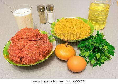 Ingredients For Cooking Meatballs: Minced Meat, Breadcrumbs, Milk, Egg, Onion, Oil, Fresh Herbs, Sal