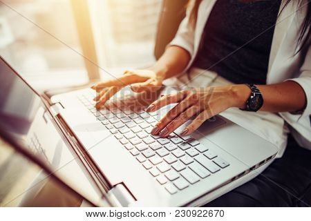 Close-up Image Of Female Hands On Keyboard. Woman Working On Laptop.