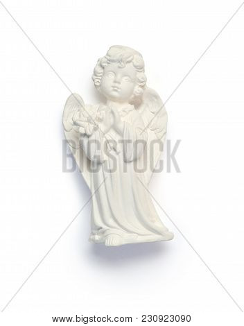 Small Plaster Angel. Symbol Of Easter Isolated Clipping Mask On White Background With Path, Top View