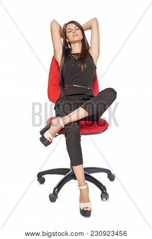 Woman Sitting On Office Chair Having Rest With Closed Eyes And Hands Over Head, Full Length Portrait