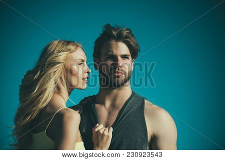 Love And Romance. Couple In Love On Blue Sky Background. Muscular Man And Woman With Long Blond Hair