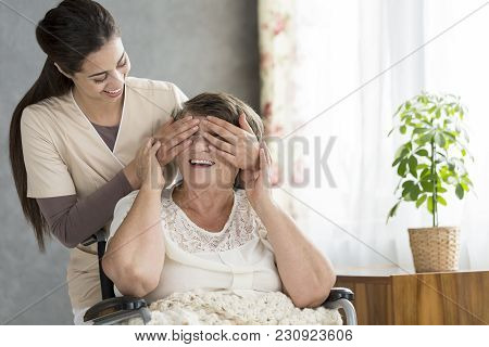 Granddaughter Covering Grandmother's Eyes