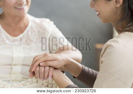 Volunteer Taking Care Of Senior