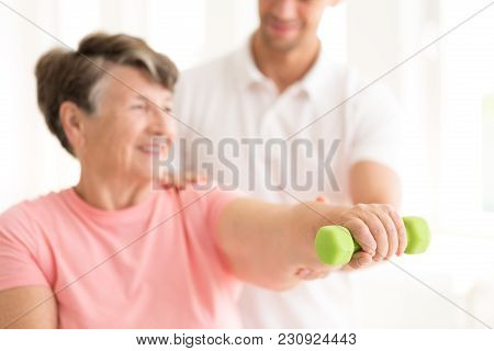 Senior Woman Exercising With Dumbbell
