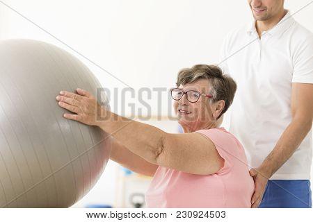 Elderly Woman Using Silver Ball
