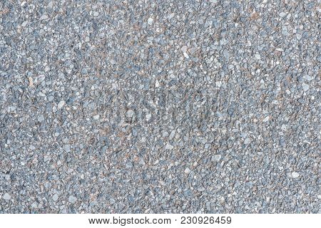 Close Up Road Surface With Pebble Stone In Concrete Floor Texture Background