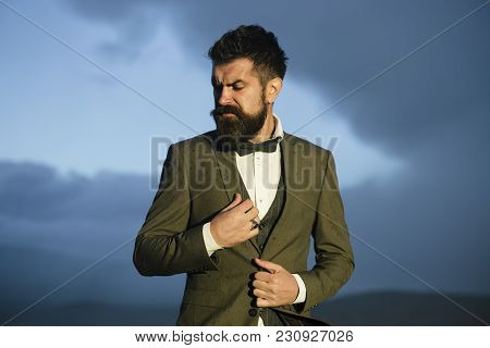 Hipster With Stylish Appearance In Front Of Dramatic Sky, Skyline. Stylish Hipster Concept. Man With